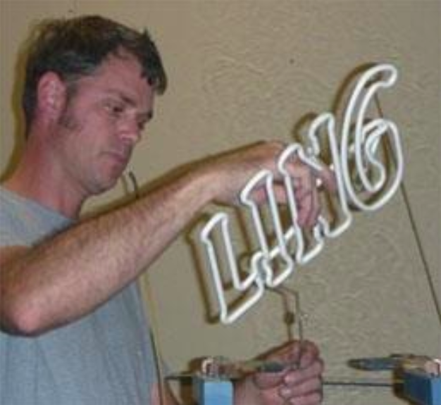 Image of Marlon working on a sign
